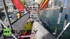 Malta: Watch semi-naked men slipping on a greasy pole