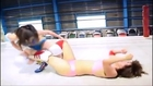 Female submission holds. Female wrestling Asian (figure 4 foldover armbar, arm lock and headlock)